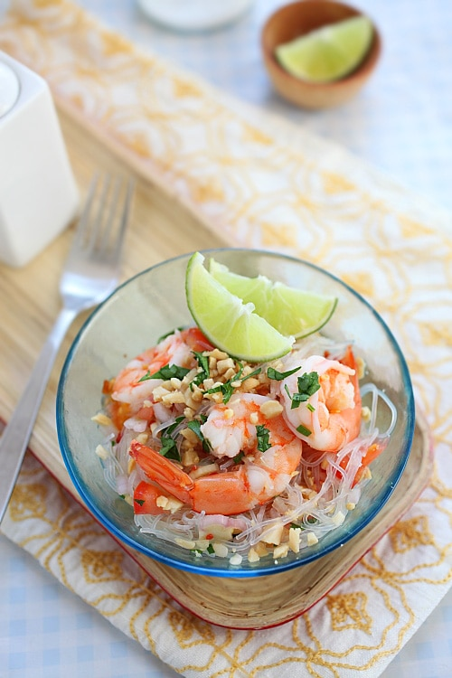 Easy and healthy homemade Thai noodle salad yum woon sen with shrimps served in a bowl.