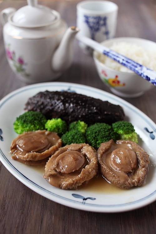Braised abalone with sea cucumber and broccoli in Chinese Malaysian style.