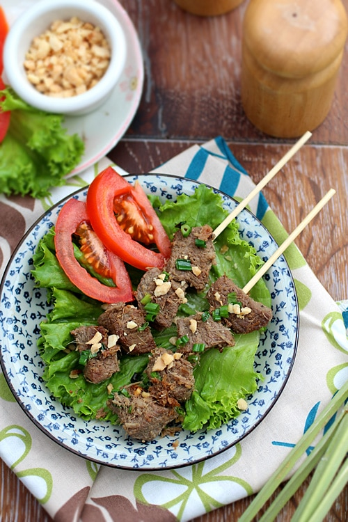 Easy and quick summer Cambodian grilled lemongrass beef skewers in a plate.