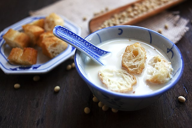 Salty soy milk served with Chinese youtiao in a bowl.
