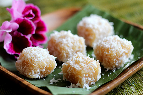 Cassava coated with shredded coconut.