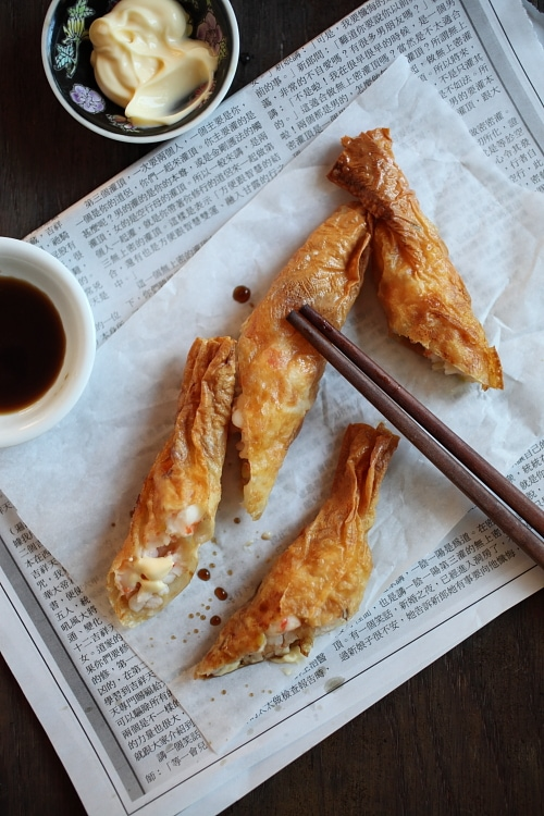 Easy and quick Hong Kong crispy shrimp rolls appetizer with a pair of chopsticks.
