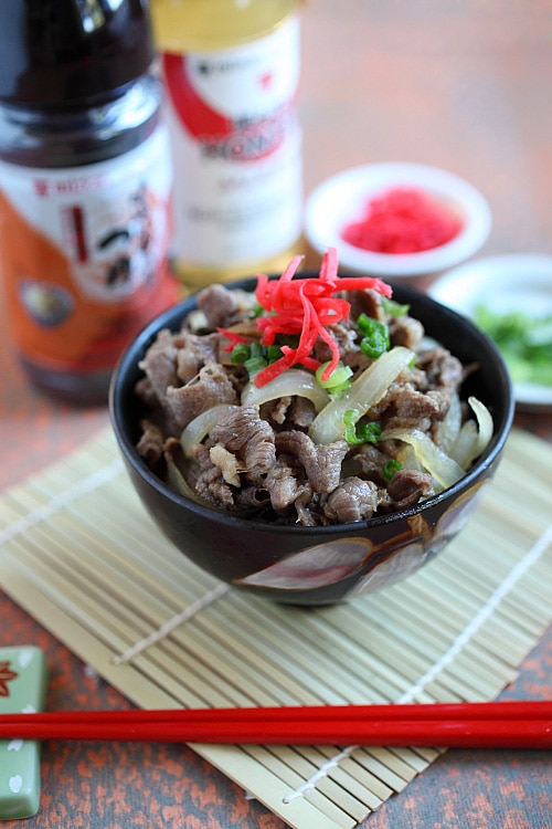 Bowl of Japanese Beef Bowl (Gyudon) with onion scallions and pink beni shoga