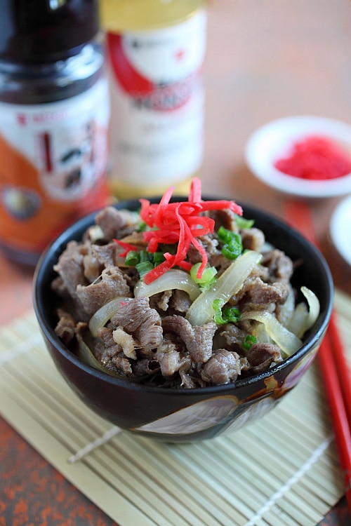 Gyudon Japanese Beef Bowl in serving dish topped with scallions and beni shoga.