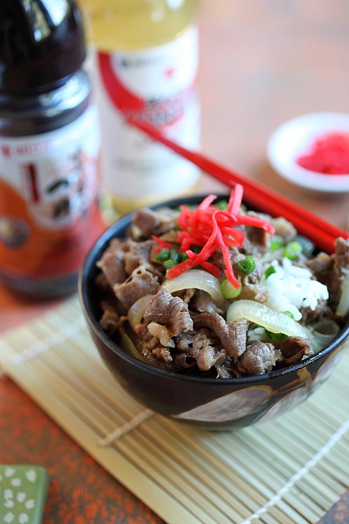 Japanese teppanyaki style beef stir fry with brown Japanese sauce on top of a bowl of steamed rice.