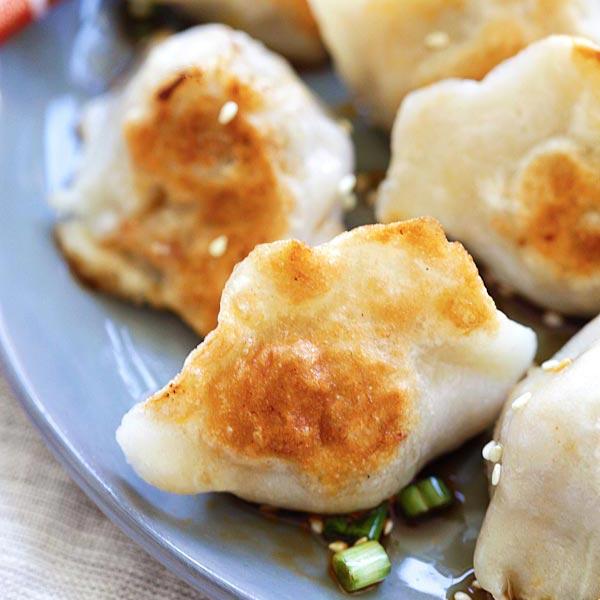 Pan-fried Dumplings - BEST dumplings recipe you'll find online! Juicy, crispy dumplings with meat, veggies and pan-fried to golden perfection   rasamalaysia.com