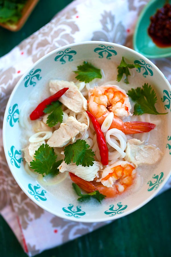 Rich and tasty homemade Thai coconut lime noodle soup with shrimps ready to serve.
