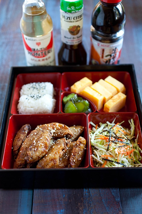 Easy and quick Japanese crispy chicken wings served in a bento lunch box.