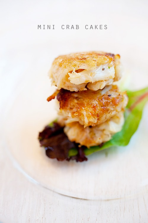 Crab cakes stacked together and served on a plate.
