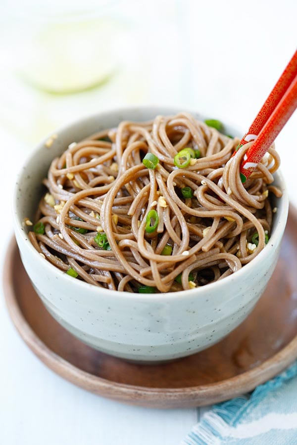 Ginger Soy Soba with ginger, soy sauce, honey and Japanese soba noodles in a bowl.