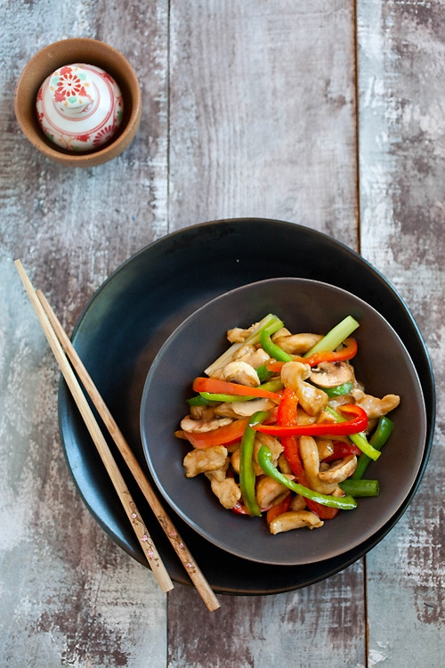 Top down view of easy and delicious Chinese stir fry chicken dish with bell peppers in brown sauce.