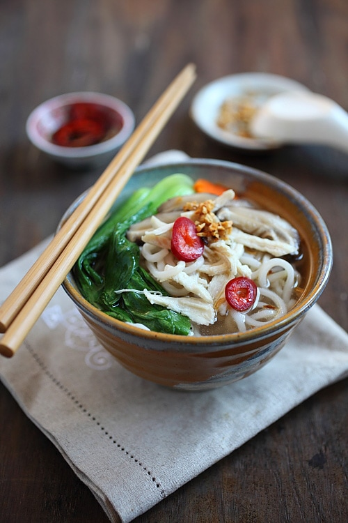 Chinese noodle soup with chicken, bok choy vegetables and noodles in a bowl.