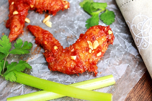 Delicious homemade Thai fried chicken wings with red spicy sauce.
