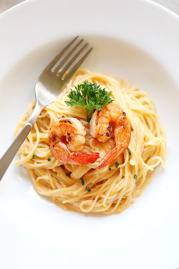 Japanese fusion creamy and delicious uni sea urchin pasta topped with grilled shrimps.