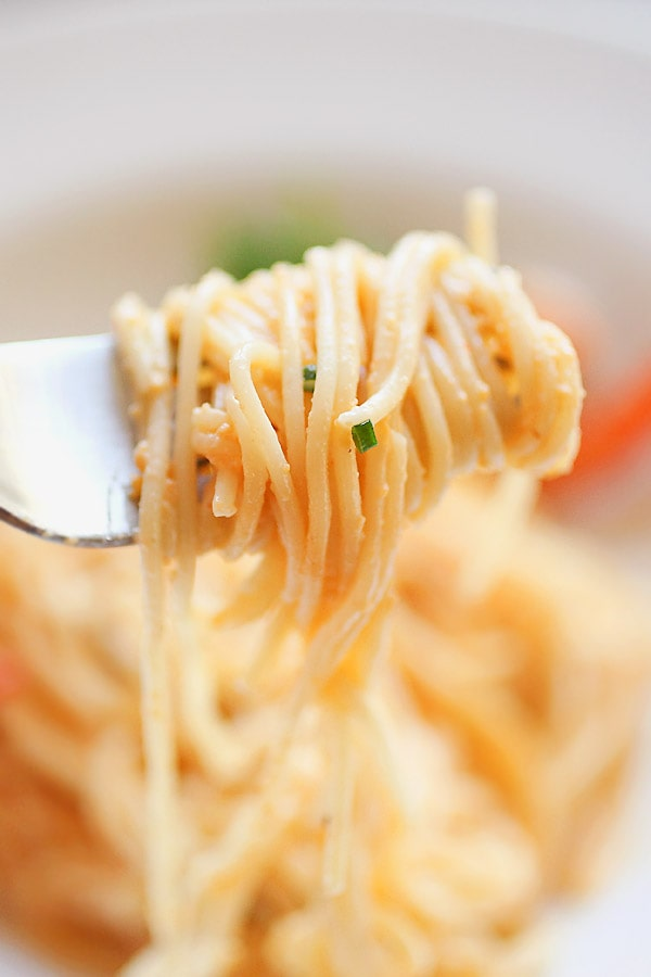 Easy and quick homemade uni sea urchin spaghetti pasta with a fork, ready to serve.