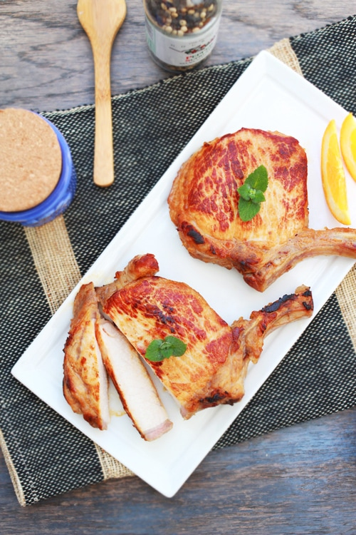 Easy homemade skillet brined pork chops on a plate.