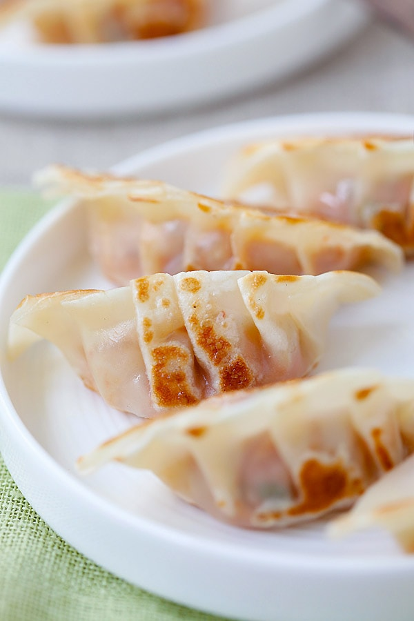 Pork and Shiitake Gyoza - healthy and delicious Japanese dumplings that you can make at home with this super easy and fool proof recipe.   rasamalaysia.com