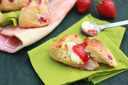 Easy and delicious strawberry scones served with strawberry jam and butter spread, ready to serve.