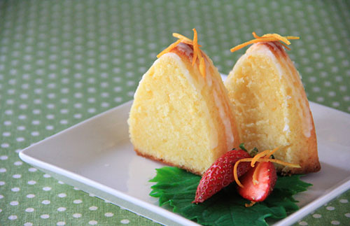 Easy homemade Sicilian orange butter cake in pieces, ready to serve.