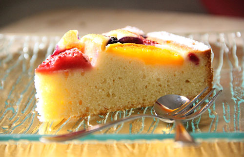 A slice of fruity pastry cake, ready to serve.