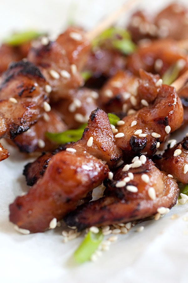 Sticky and sweet honey sesame chicken skewers sprinkled with sesame seeds.