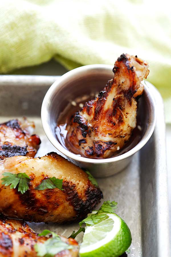 BBQ chicken wings with lemongrass and Asian seasonings dipped in chicken wing sauce.
