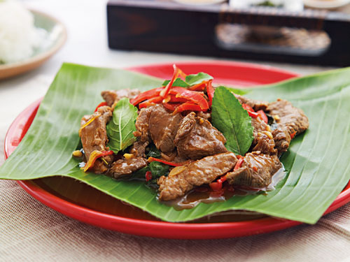 Easy and delicious Thai beef with red chili paste stir fry, served in a plate.