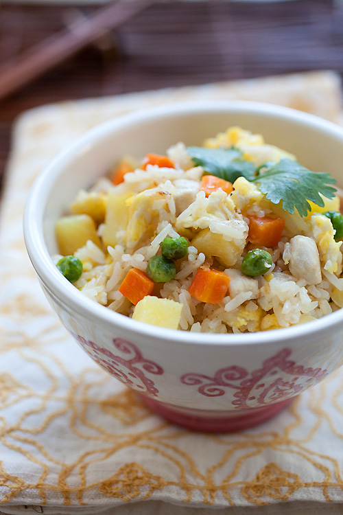 Healthy homemade Thai chicken pineapple fried rice, served in a bowl.