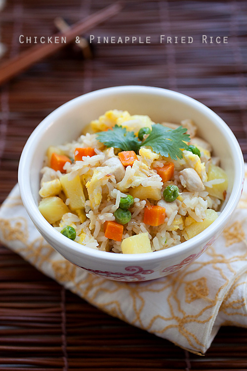Easy and delicious Asian chicken and pineapple fried rice recipe served in a bowl.