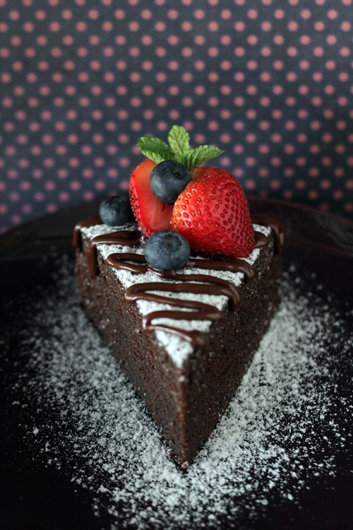 Easy and quick no bake chocolate cake decorated with fresh berries.