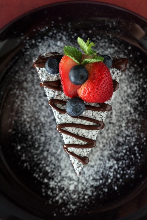 Top down view of a piece of easy no bake chocolate cake, served in a plate.