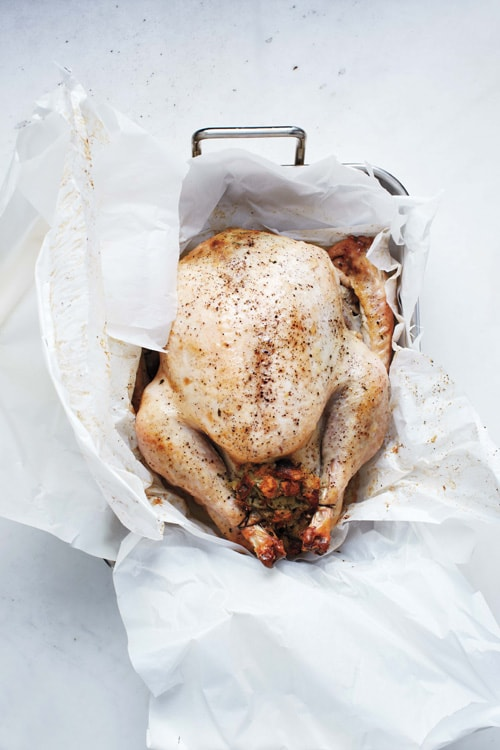 Easy homemade Thanksgiving roasted whole turkey recipe using parchment paper.