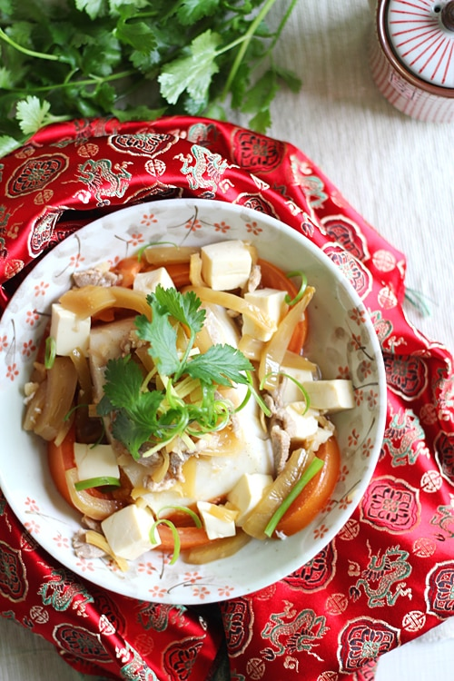 Easy Chinese Teochew steamed fish served in a plate.