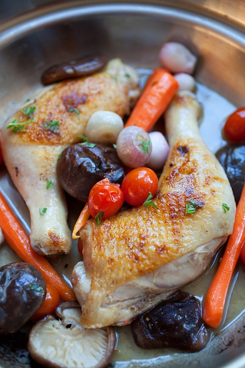 Braised chicken in skillet.