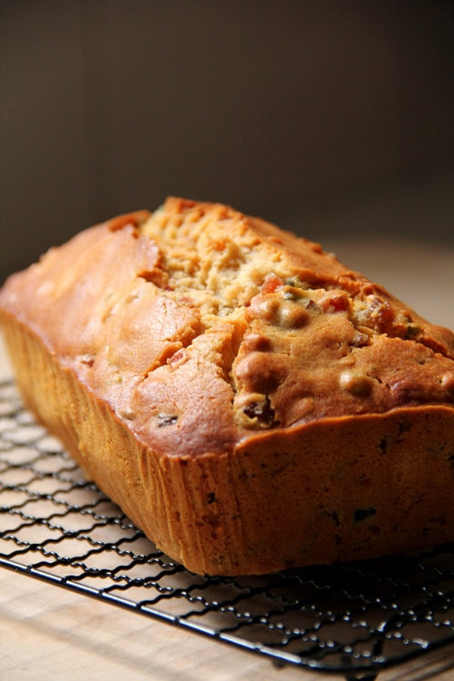 Easy and healthy homemade festive Irish mixed fruits tea bread loaf placed on a cooling rack.