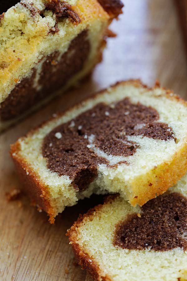Taking a bite from a piece of homemade marble cake made with cocoa powder.