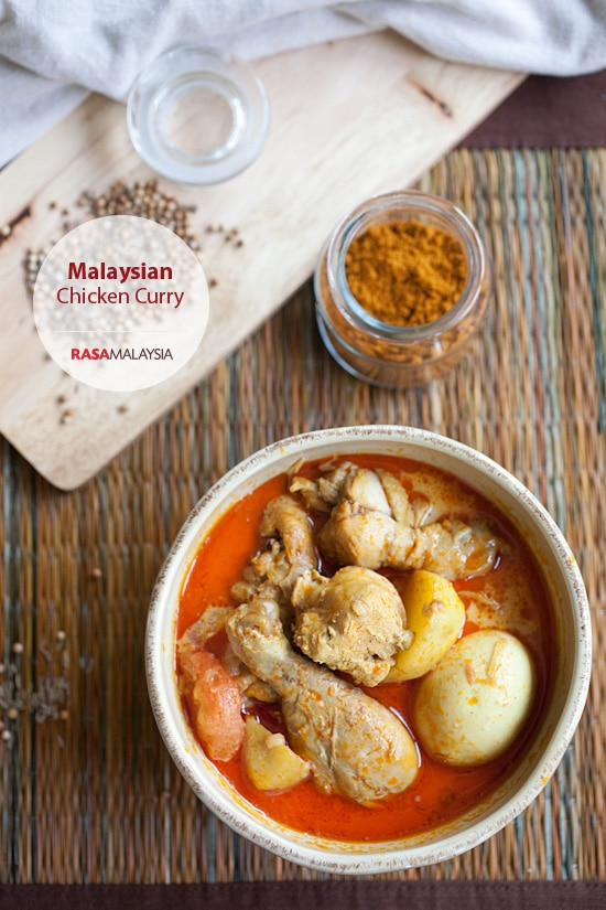 Malaysian Chicken Curry in bowl with curry chicken drumsticks, potatoes and onions.
