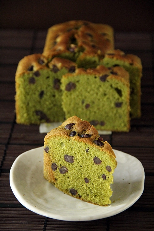 A piece of easy Japanese matcha green tea pound cake with Azuki beans, served in a plate.