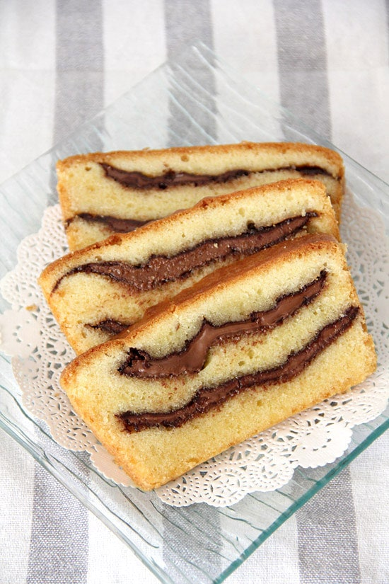 Three pieces of Nutella swirled pound cake on a plate, ready to serve.