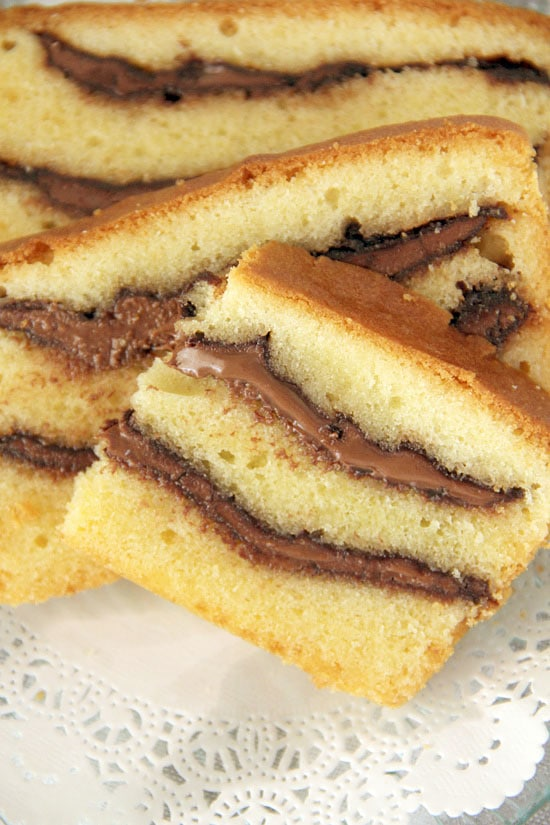 Easy recipe for thick, gooey Nutella swirls in rich buttery pound cake.