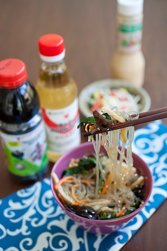 Easy and quick Korean Japchae with easy Korean sauce picked by a pair of chopsticks ready to serve.