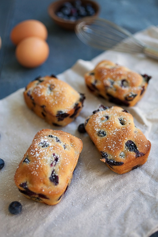 Easy and quick cute mini blueberry cakes on a piece of kitchen cloth.