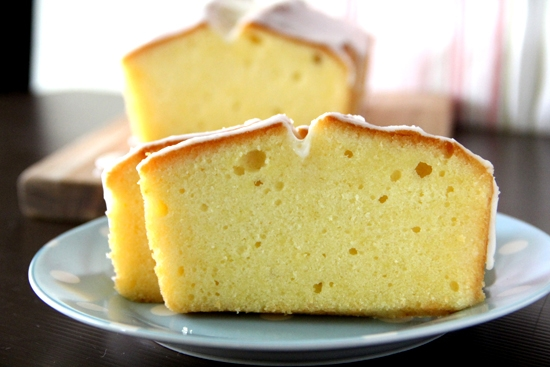 Sliced Meyer lemon pound cake with lemon sugar glaze.