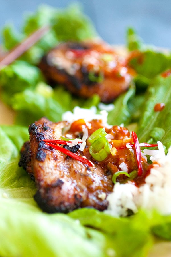 Korean BBQ Chicken (Dak Gogi) served with Korean spicy dipping sauce, rice and lettuce leaves.