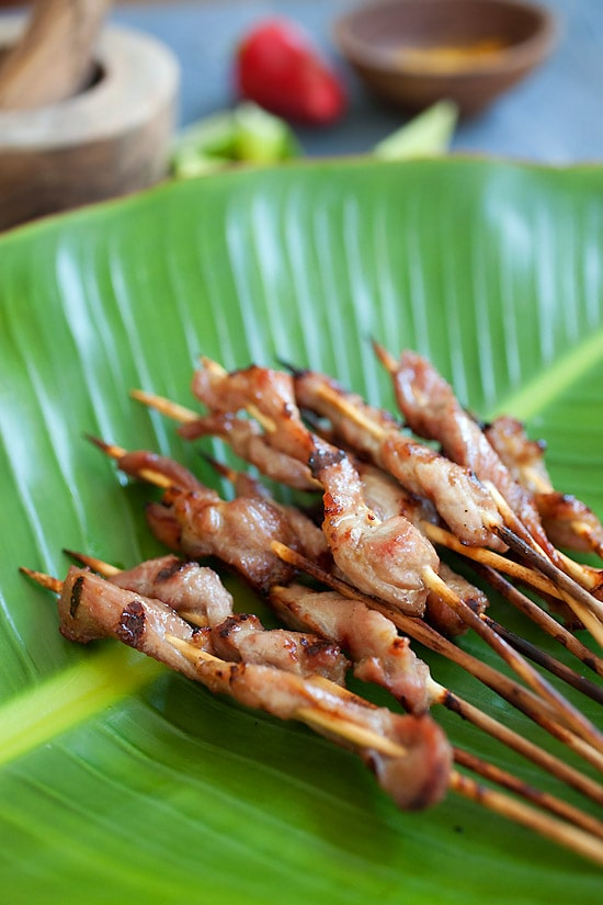 Thai pork satay with sweet coconut milk glaze on top of banana leave.