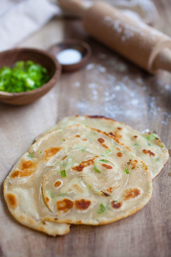 Chinese scallion crispy pancake, pan-fried to golden brown. Delicious and ready to be eaten.