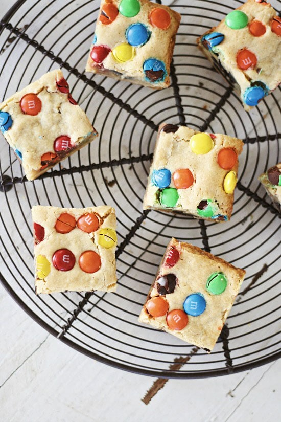 Easy homemade M&M's and Oreo Cookies Bars on cooling rack.