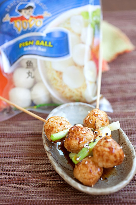 Fish ball skewers with glazed teriyaki sauce in a serving dish.
