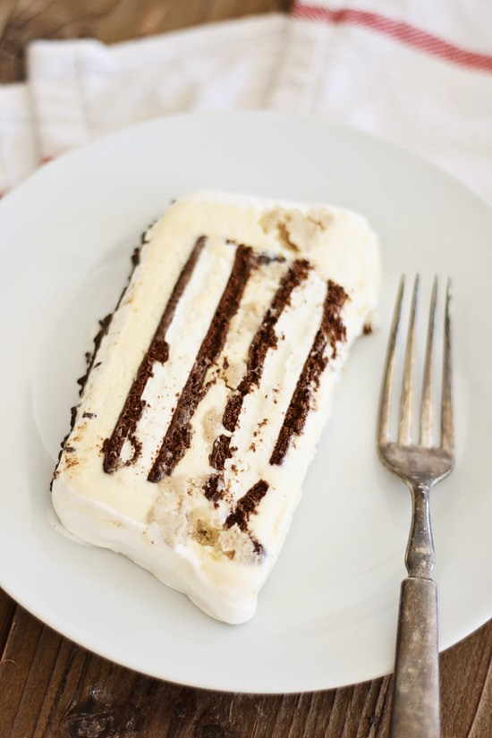Cookie dough ice cream cake recipe using chocolate chip cookie dough and ice cream with cool whip topping. Decadent and delicious ice cream cake | rasamalaysia.com