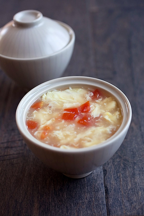 Egg drop soup recipe. This egg drop soup calls for 3 ingredients: eggs, tomatoes, and chicken broth and takes 10 minutes to make! | rasamalaysia.com